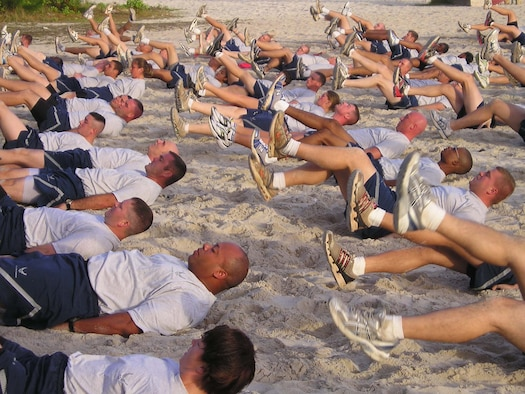 "Airmen from the 36th Contingency Response Group conduct a morning workout at Tarague Beach to stay ""Fit to Fight."" The 36 CRG's physical training is structured to keep the Airmen from the group in top physical condition and ready to respond to any call short-notice deployment. The groups' structured PT involves the entire squadron and works to bolster morale as well as to stay in shape.  (Courtesy Photo)"