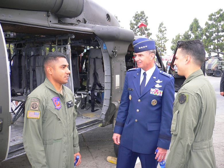 Gen. Kevin Chilton, Air Force Space Command commander, talks with soldiers at the Del Amo Mall. The mall was the site of numerous displays representing all Armed Forces as part of the 2007 Torrance Armed Forces Day celebration. The general served as the Grand Marshal for the parade. A Los Angeles AFB honor guard led the way as Los Angeles, Edwards, and Vandenberg Air Force Bases and March Air Reserve Base marched passed the crowds with a total of more than 300 airmen participating.