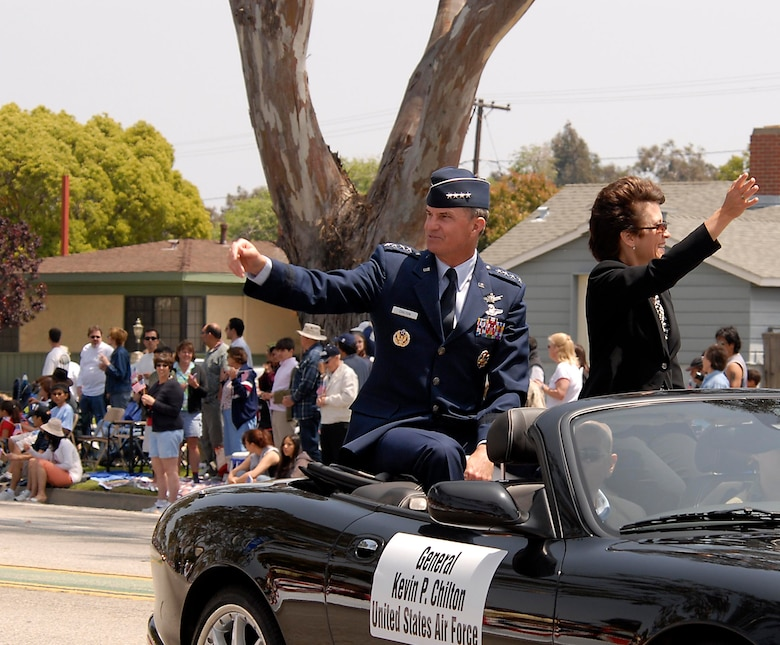 Gen. Kevin Chilton, Air Force Space Command commander, and his wife wave to the crowd durng the Torrance Armed Forces Day Parade. The general served as the parade's Grand Marshal. A Los Angeles AFB honor guard led the way as Los Angeles, Edwards, and Vandenberg Air Force Bases and March Air Reserve Base marched passed the crowds with a total of more than 300 airmen participating.