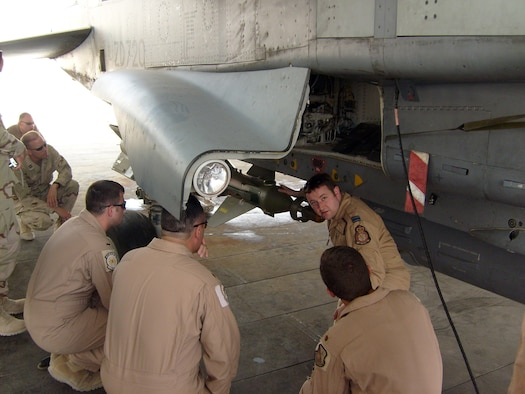SOUTHWEST ASIA -- British Royal Air Force Flight Lieutenant Stuart Wallace, 901st Exeditionary Air Wing weapons system officer, explains the GR4 Tornado aircraft to personnel assigned to the 379th Air Expeditionary Wing. Every Friday the 379th Expeditionary Operations Support Squadron hosts the Mission Designated Series of the Week program to Airmen, Soldiers, Sailors, Marines and coalition partners in an effort to promote awareness of the aircraft deployed here and the roles they play in the Global War on Terrorism.