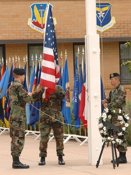 27th Security Forces Squadron Airmen lower the flag May 18 in memory of all fallen law enforcement officers at a retreat ceremony during National Police Week May 13-19. (U.S. Air Force photo by Senior Airman Heather Redman)