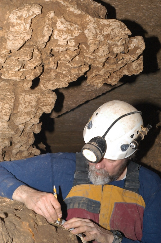Brian Roebuck makes notes during a mapping and surveying project for the local chapter of the National Speleological Society inside a cave in Maury County, Tenn. Roebuck is an Aerospace Testing Alliance (ATA) engineer at the Arnold Engineering Development Center, Arnold Air Force Base, Tenn. ATA is the support contractor for the base. (Photo by Lynn Roebuck)