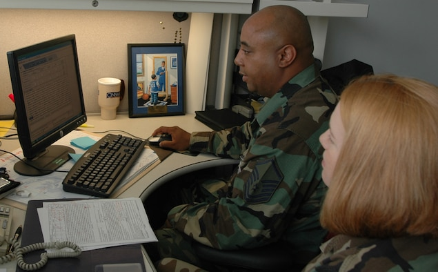 Master Sgt. Edwin Holland, 374th Dental squadron, provides Enlisted Performance Report mentorship to Staff Sgt. Amber Bulls, 374DS. Sergeant Holland was recently nominated for the National Association of Colored People Roy Wilkins Award. (U.S. Air Force photo by Airman 1st Class Eric Summers VIRIN 070521-F-9864S-055)