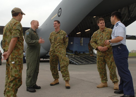 Personnel from teh United States Air FOrce, Royal Australian AIr Force and Japan Air Self Defense Force discuss air mobility operations during the Pacific Global AIr Mobility Seminar. ( U.S. Air Force photo by Senior Airman Veronica Pierce VIRIN 070518-F-3177P-033)