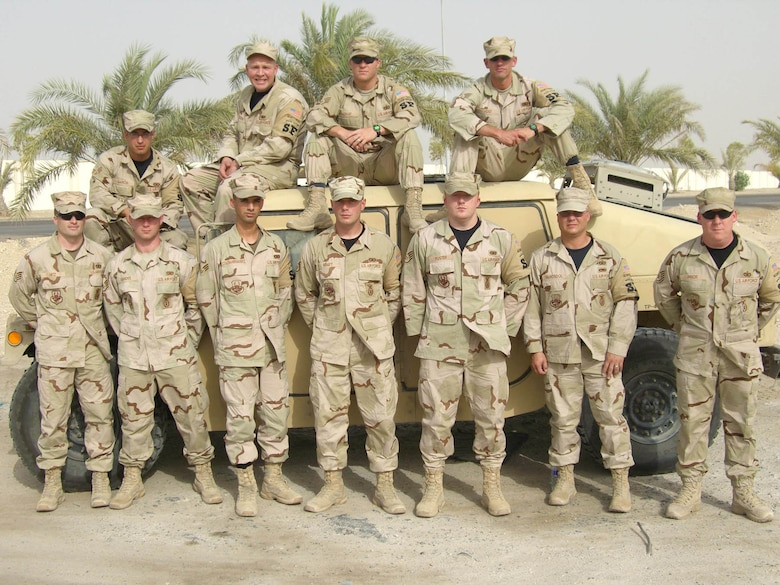 """""""The 380th Air Expeditionary Wing Defenders, or """"Desert Rats,"""" wish everyone a happy Memorial Day form the sand box."""" -- 22nd Security Forces Squadron members. (Photo by Master Sgt. Bobby Burgess)"""