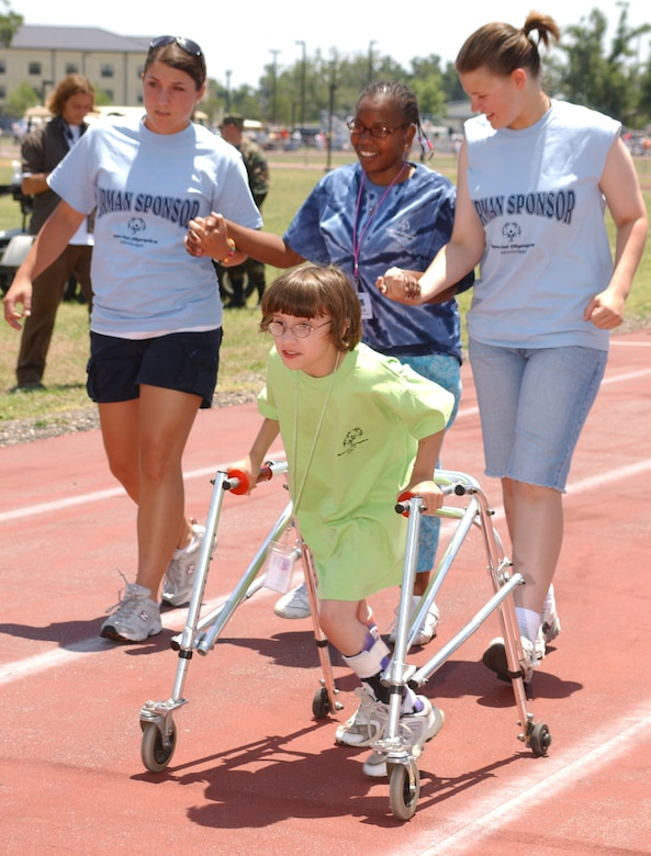 Rachel Cato leads, from left, Laura Donaldson, 334th Training Squadron, Shawn Chocolate and Caitlin Kettle, 334th TRS, down the track during the 25-meter assisted walk.   (U. S. Air Force Photo by Kemberly Groue)