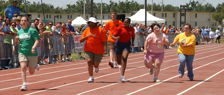Athletes Melissa Thomas, Rickeya McCoy, Lawson Christopher, Marquitta Moore, Angela Raney and Lacey Pierce, Area 10, sprint toward the finish line in the 50-meter-dash Saturday at the Triangle track.  (U. S. Air Force Photo by Kemberly Groue)