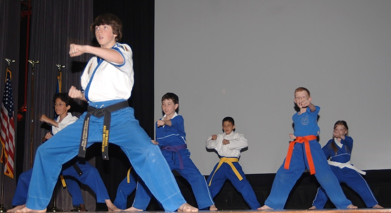 Members of Shakur's Martial Arts showcase their talents at a karate demonstration for Asian Pacific Heritage Month at the base theater Friday. Classes for youths and adults are helf at 6 p.m. Mondays and Wednesdays at the CAFB Community Center. For more information, call 425-0334.