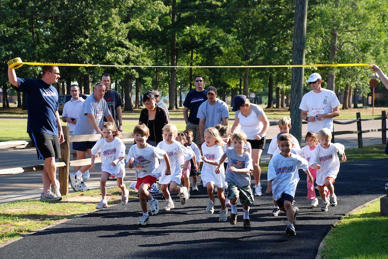 Youth, ages five and six, take off  at the start of the Annual America's Kids Run Saturday at the track. (U.S. Air Force Photo)