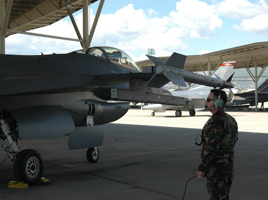 Technical Sgt. Matt Bennato, an Air Reserve Technician with the 419th Fighter Wing, prepares to launch a 34 Fighter Squadron F-16 May 23.  This is the second day Reserve aircraft maintenance Airmen have worked beside active duty Airmen in the 34th Aircraft Maintenance Unit. (U.S. Air Force photo by 2nd Lt. Beth Woodward)