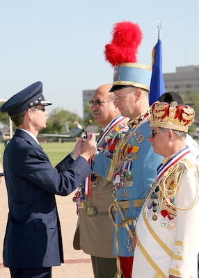 Brig. Gen. Darrell Jones presents King Antonio LXXXV Joe Peacock a Lackland medallion at the annual Lackland Fiesta Military Parade held April 25, 2007, at the base parade grounds. Jorge Gonzalez, president of the 2007 Fiesta San Antonio Commission, and El Ray Feo LIX Brian Weiner also received Lackland Fiesta medals during the parade. General Jones is a former commander of the 37th Training Wing. (USAF photo by Robbin Cresswell)