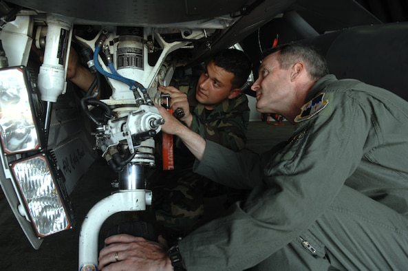 "SPANGDAHLEM AIR BASE, GERMANY -- Col. Darryl Roberson, 52nd Fighter Wing commander, checks F-16 landing gear with Airman Jeff Kakaley, 52nd Aircraft Maintenance Squadron, May 21. Airman Kakaley, a Harleigh, Pa., native, is an assistant dedicated crew chief who has been in the Air Force for one year. Airman Kakaley's supervisor, Senior Airman Joshua Teakles, said, ""Airman Kakaley is a highly motivated Airman who has excelled at being an F-16 crew chief. He is a quick learner who shows great potential to go far and do great things in the U.S. Air Force."" Airman Kakaley's personal goals are to finish a teaching degree and score a 95 percent or better on his Career Development Course exam. (US Air Force photo/Senior Airman Josie Kemp)"