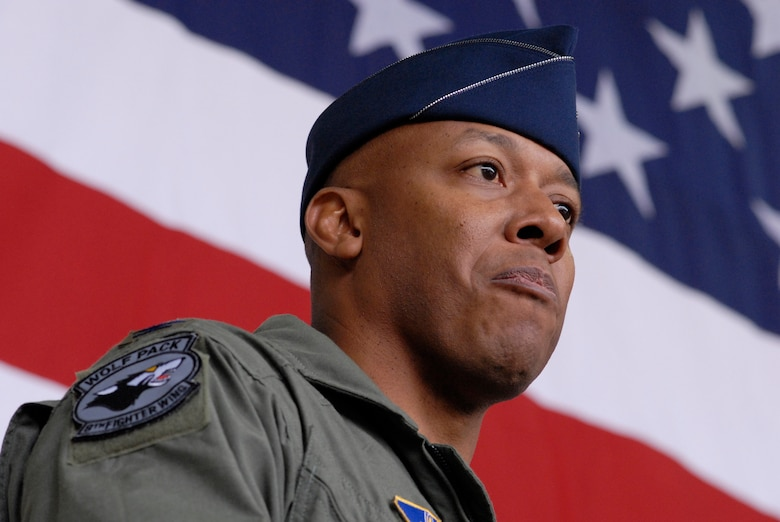 """Colonel Charles """"Wolf"""" Brown, the new 8th Fighter Wing commander, speaks to the wing for the first time during his change of command ceremony here May 25. During his speech, he said he will lead the Wolf Pack """"using four tenets that have defined how I have operated during my career -- execute at a high standard, be disciplined in execution, pay attention to the details, and have fun."""" He was last assigned as commandant, U.S. Air Force Weapons School, 57th Wing, Nellis Air Force Base, Nev.  (U.S. Air Force photo by Senior Airman Barry Loo)"""