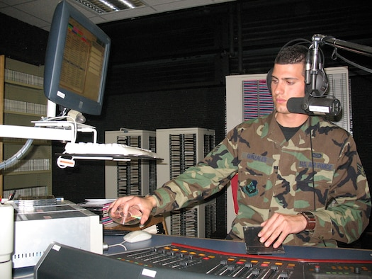 SPANGDAHLEM AIR BASE, GERMANY -- Senior Airman Richard Gonzales, American Forces Network Eifel Detachment 9 broadcaster, performs duties as a radio and television broadcast journalist at AFN, located at Bitburg Air Base. He has wanted to be a broadcaster for as long as he remembers. (US Air Force photo/Staff Sgt. Brandon Hoyt)