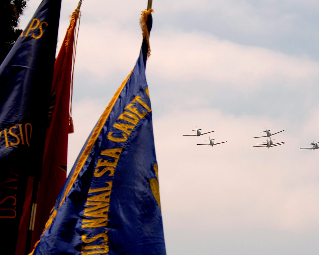 WW II-era T-6 trainer aircraft, piloted by members of the Condor Squadron, flyover the Los Angeles National Cemetery during this year's Memorial Day salute, May 28. Lt. Gen. Michael Hamel, SMC Commander, was the keynote speaker.
