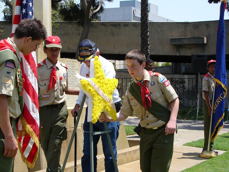 Aided by members of Boy Scout Troop 283, a WW II vet placed flowers at the 59th Annual Inglewood Memorial Day Service, May 28. The service honored fallen heroes from the city and was attended by veterans who served from World War II to Operation Iraqi Freedom. Col. Douglas Kendall, Spacelift Range Group Commander was the keynote speaker.