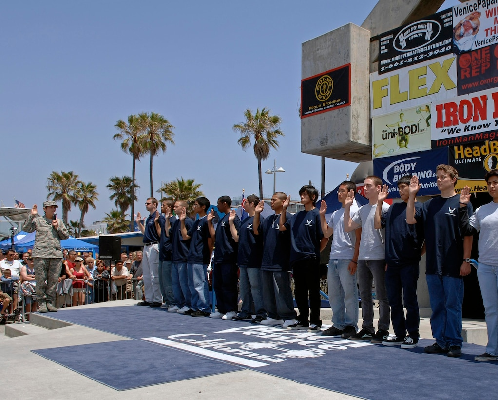 Brig. Gen. Ellen Pawlikowski, Military Satellite Systems Wing Commander, swears in new recruits at the Muscle Beach Memorial Day celebration in Venice, Calif., May 28