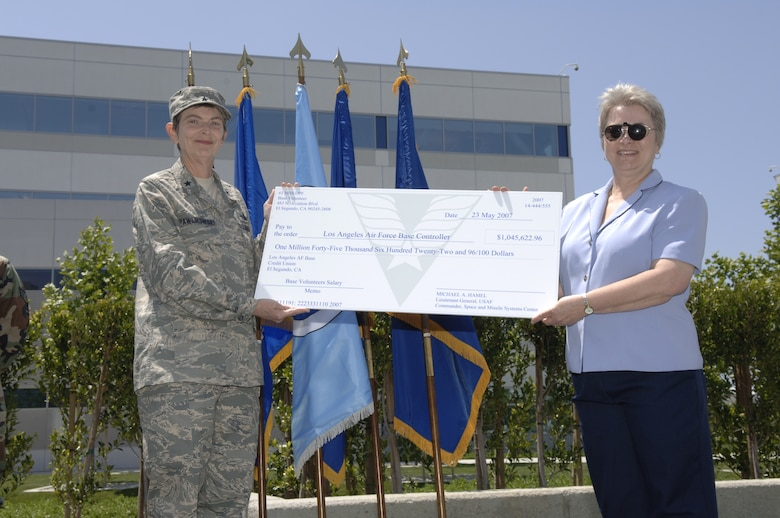 Brig. Gen. Ellen Pawlikowski accepts a check representing the money base volunteers saved by giving of their time.  Base volunteers worked 57,925 hours from April 1, 2006 through March 31 2007, saving the base $1,045,622.96 in salaries. Los Angeles Air Force Base celebrated the work of more than 290 volunteers at the annual Volunteer Recognition Ceremony and luncheonat the Schriever Space Complex, May 23. Approximately 125 volunteers and their supervisors attended the event.