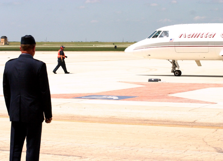 LAUGHLIN AIR FORCE BASE, Texas -- Col. Dan Clark watches as a small charter plane taxis U.S. Army Pvt. Oscar Sauceda Jr's, 21, remains. The infantryman was killed May 22 in Baghdad by small arms fire, and touched down at Laughlin May 28. (U.S. Air Force photo by Airman Sara Csurilla)