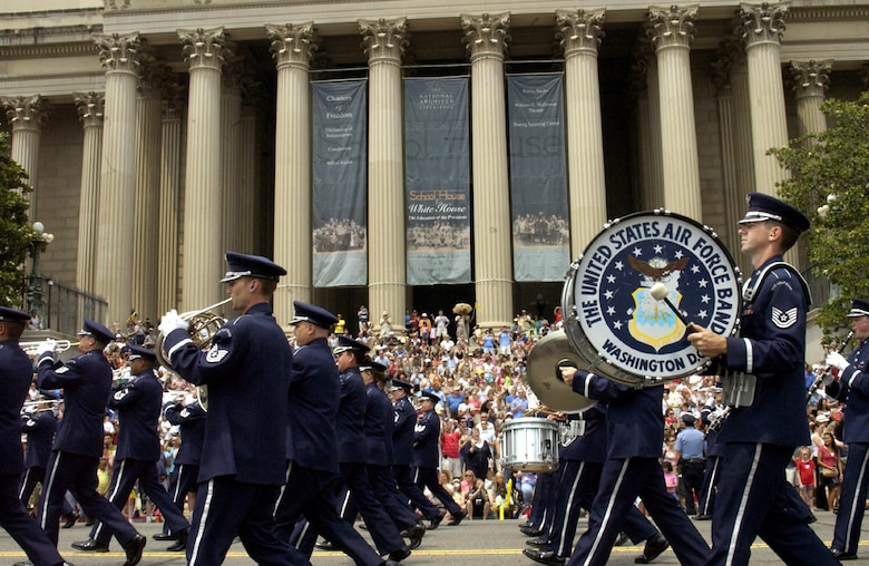 Airmen from the Air Force Band march in front of the National Archives during the National Memorial Day Parade May 28 in Washington, D.C. The parade highlighted the Air Force's 60th anniversary as a separate service. Maj. Gen. Robert L. Smolen, the Air Force District of Washington commander, served as the grand marshall for the parade; Secretary of the Air Force Michael W. Wynne and Chief Master Sgt of the Air Force Rodney J. McKinley also attended. (U.S. Air Force photo/Staff Sgt. J.G. Buzanowski)