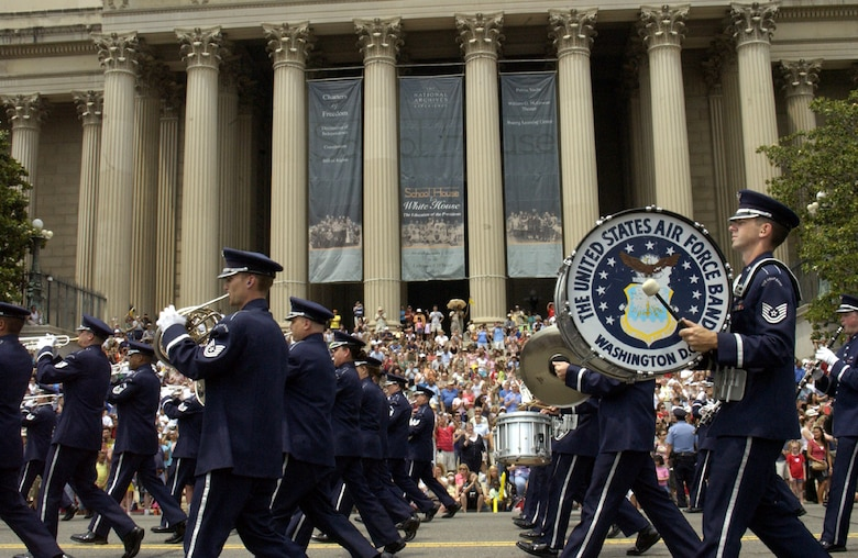 Airmen from the U.S. Air Force Band march in front of the National Archives during the National Memorial Day Parade Monday. The parade highlighted the Air Force's 60th anniversary as a separate service and featured several well-known Airmen. Maj. Gen. Robert L. Smolen, Air Force District of Washington commander, served as the grand marshall for the parade; Secretary of the Air Force Michael Wynne and Chief Master Sgt of the Air Force Rodney McKinley attended as well. In addition, members from all services represented the efforts of fighting men and women through every war and conflict since the early days of the nation. (U.S. Air Force photo by Staff Sgt. J.G. Buzanowski)