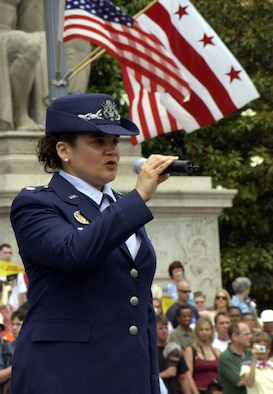 "Maj. Kat Strus, from the Air Force District of Washington A1 office, sings the ""Star-Spangled Banner"" at the National Memorial Day Parade Monday. The parade highlighted the Air Force's 60th anniversary as a separate service and featured Airmen from the U.S. Air Force Band and Honor Guard. Maj. Gen. Robert L. Smolen, Air Force District of Washington commander, served as the grand marshall for the parade; Secretary of the Air Force Michael Wynne and Chief Master Sgt of the Air Force Rodney McKinley attended as well. In addition, members from all services represented the efforts of fighting men and women through every war and conflict since the early days of the nation. (U.S. Air Force photo by Staff Sgt. J.G. Buzanowski)"