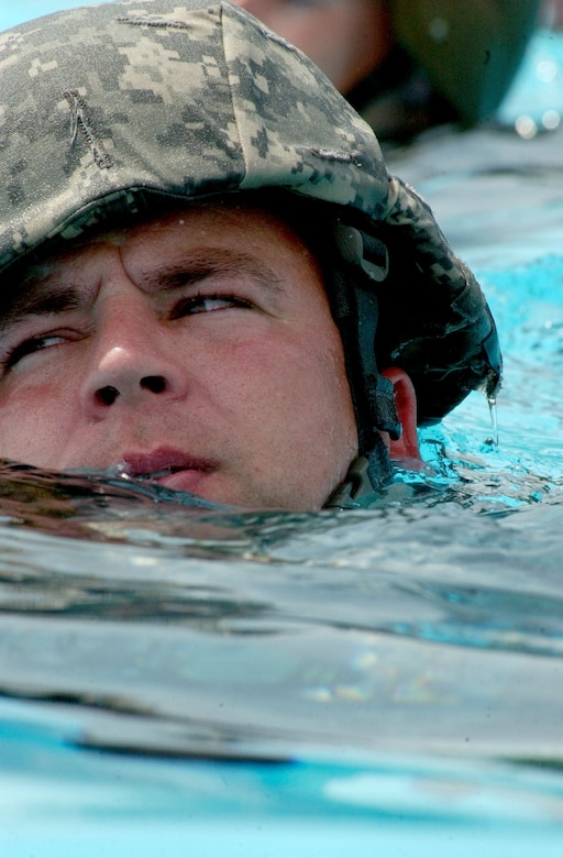 Staff Sgt. Brian Grishaw, a member of  Soto Cano Air Base Search and Rescue team, keeps his head above water during combat water survival/drownproofing training at the base pool May 22, 2007.  U.S. Air Force photo by Senior Airman Shaun Emery.