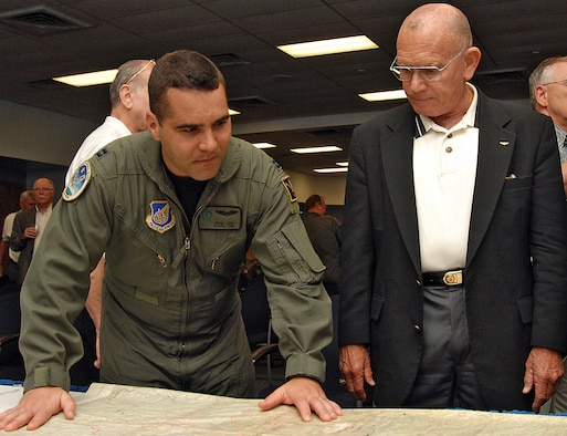 Capt. Greg Laird, a 210th Rescue Squadron pilot, Eielson AFB, Alaska, looks over a map of Laos with retired Marine Maj. Gen. Larry Taylor at the Society of Combat Search and Rescue?s 10th annual reunion here May 18. The Society of CSAR is a group of servicemembers with combat search and rescue experience that assemble to share their experiences with the public and current combat search and rescue servicemembers. U.S. Air Force photo by Todd Berenger