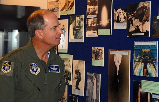 Gen. Kevin P. Chilton, Air Force Space Command commander, views historic pictures of the Air Force?s space heritage May 15 at the Air Force Research Laboratory conference room here. The general visited the base to tour space command units and hold a commander?s call for personnel. U.S. Air Force photo by Laurence Zankowski