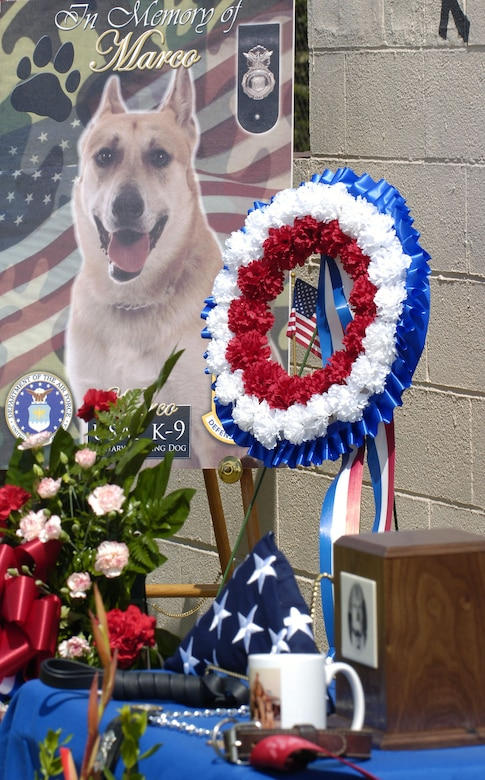 A display stands in memory of Marco, a military working dog killed Jan. 19 while on patrol in Baghdad, Iraq, during a recent memorial ceremony at Tinker Air Force Base, Okla.  Marco was assigned to the 72nd Security Forces Squadron at Tinker.  (U.S. Air Force photo by Dave Faytinger)