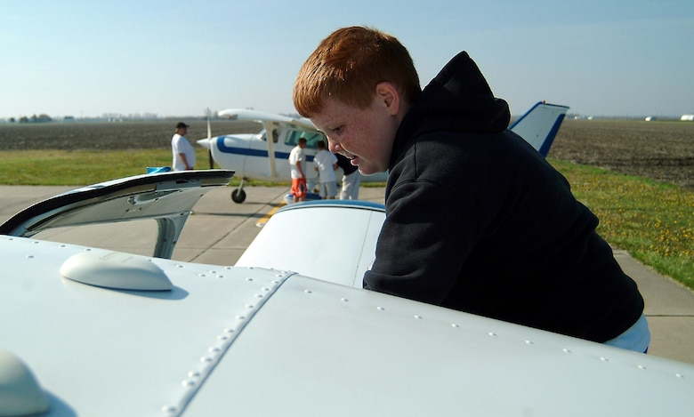 As a reward for successful completion of the 442nd Fighter Wing-sponsored Wright Flight mentoring program, Rory McGraw, a sixth-grade student at Hardin Central School in Hardin, Mo., climbs into an airplane for his flight over central Missouri at the culmination of this year's Wright Flight program. Area private pilots provided the flights to the students for free during the Wright Flight fly day April 21 at the airport in Carrollton, Mo. The 442nd FW is an Air Force Reserve Command A-10 Thunderbolt II fighter unit based at Whiteman Air Force Base, Mo. (U.S. Air Force photo/Master Sgt. Bill Huntington)