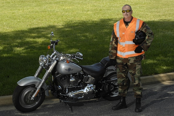 Tech. Sgt Lester Nelson, 11th Civil Engineer Squadron, shows the proper saftey equipment for motorcycle riding, bright vest, helmet, gloves, eye protection, long sleeved shirt and pants. (U.S. Air Force photo by Senior Airman Dan DeCook)