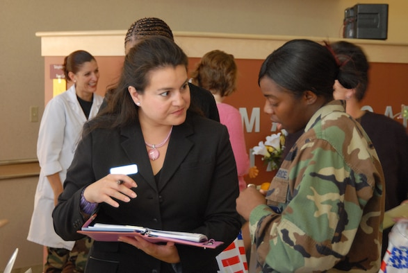 Patricia Soto (left), a Mary Kay consultant, gives cosmetic information to 2nd Lt. Katrina Powell, a human factors engineer with the 418th Flight Test Squadron, during the Women's Health Fair at the base clinic May 22. (Photo by Airman Mike Young)