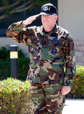 Col. Bryan Gallagher, 95th Air Base Wing commander, salutes the wing formation during his Assumption of Command ceremony at building 1 here May 29. (Photo by Mike Cassidy)