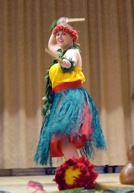 """Alisha Tampon, a customer service representative for Rohmann Services, performs a Hawaiian dance during the Asian-Pacific Islander Heritage Month luncheon at the Oasis Community Center here May 23. The theme of the event was """"Pursuing Excellence though Leadership, Diversity and Unity."""" (Photo by Mike Cassidy)"""