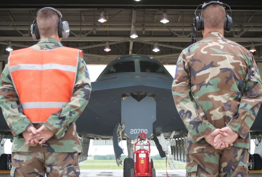 Senior Airmen Eric Hinckley (left) and Christopher Smith, 509th Aircraft Maintenance Squadron, prepare to launch a B-2 for a training sortie May 24. (U.S. Air Force photo/Tech. Sgt. Matt Summers)