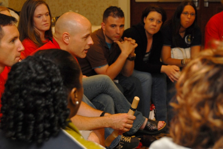 CRYSTAL CITY, Va. -- Master Sgt. Jon Wedel, an Air Force Honor Guard member, talks with other volunteer mentors at a mentor training session about his past experiences being involved in the Tragedy Assistance Program for Survivors.  Held over Memorial Day weekend, TAPS is a three-day camp children and family members who have lost a loved one in military service can attend that aims to help teach families how to grieve, as well as share their stories and make friends who share their loss.