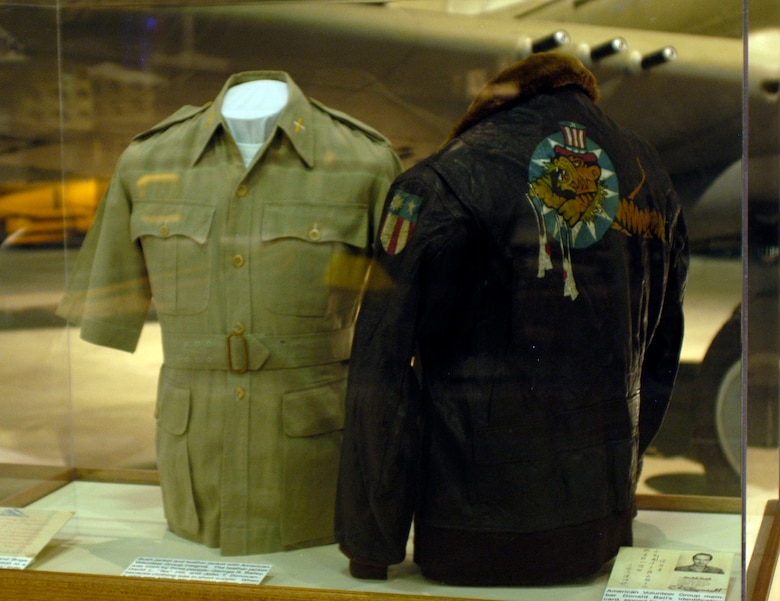 "DAYTON, Ohio -- Bush jacket and leather leather jackets with American Volunteer Group insignia on display in the World War II Gallery at the National Museum of the U.S. Air Force. The leather jacket was worn by three people -- George R. Bailey, David L. ""Tex"" Hill and John T. Donovan -- because clothing was in short supply. When a pilot was killed, his personal effects were auctioned and the money sent home. The bush jacket was worn by Henry L. Olson. (U.S. Air Force photo)"
