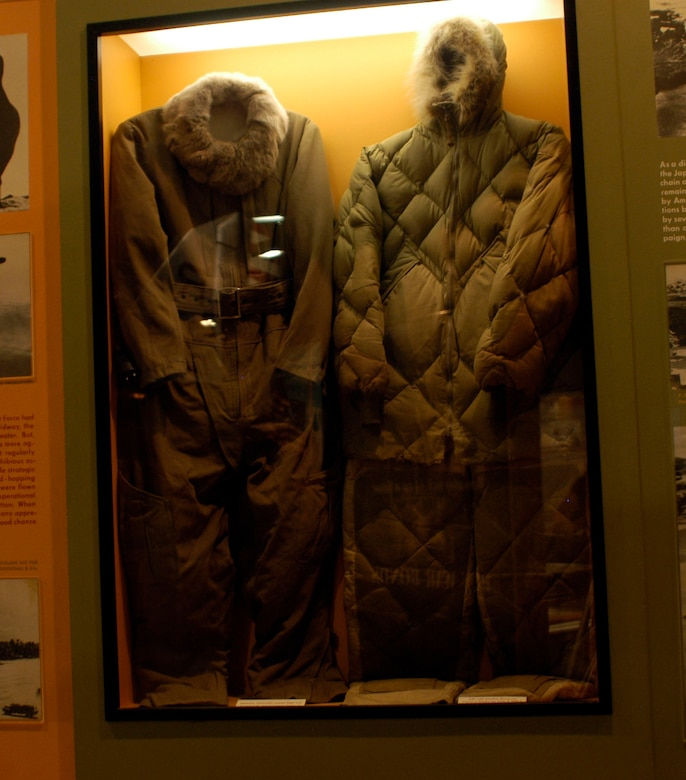 DAYTON, Ohio -- On the left is a Japanese electrically heated flight suit, and on the right is an AAF cold weather flying suit issued in Alaska for trials in 1941-1942. The Japanese flight suit was donated by Jacques E. Young from Dayton, Ohio. The AAF suit was donated by Col. (Ret.) F.B. Gallagher from Pinellas, Fla. Both are on display in the World War II Gallery at the National Museum of the U.S. Air Force. (U.S. Air Force photo)