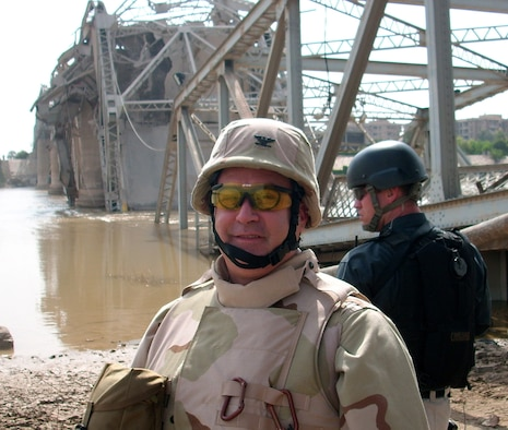 BAGHDAD, Iraq -- Col. Paul T. Babin Jr., a former Commander 439th Civil Engineering Squadron, inspects the remains of a destroyed bridge that once spanned the Tigris River. (U.S. Air Force photo)