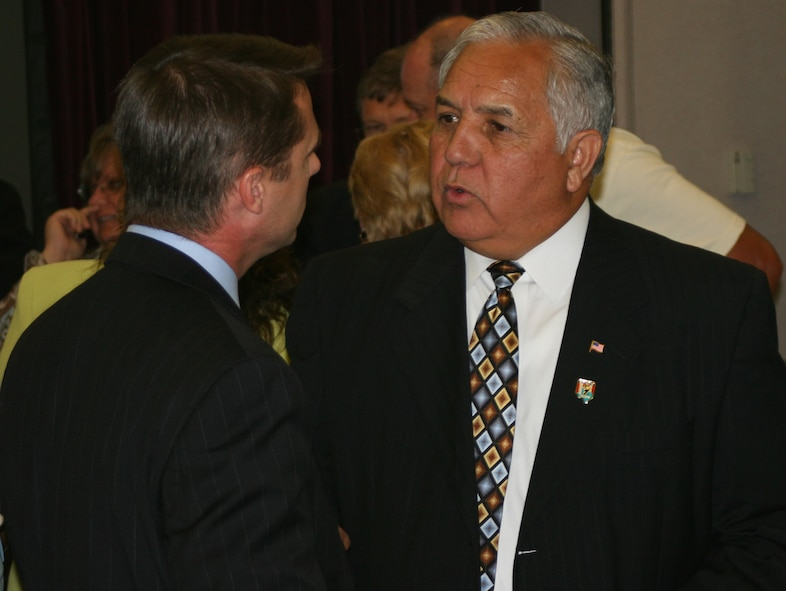 Congressman Silvestre Reyes, who represents the 16th District of Texas in the U.S. House of Representatives, talks to Todd Smith of Warrensburg, Mo., during a base community council luncheon at Mission's End May 29. As a senior member of both the Armed Services and Select Intelligence Committees, Congressman Reyes is a key member of Congress on defense and military issues.  He attended the luncheon with Missouri Congressman Ike Skelton, and U.S. Navy Rear Admiral Mark Ferguson, Navy legislative affairs chief. Congressman Reyes, who served in the U.S. Army and is a Vietnam War veteran, thanked Whiteman members for their service and patriotism.(U.S. Air Force photo/Staff Sgt. Rob Hazelett)