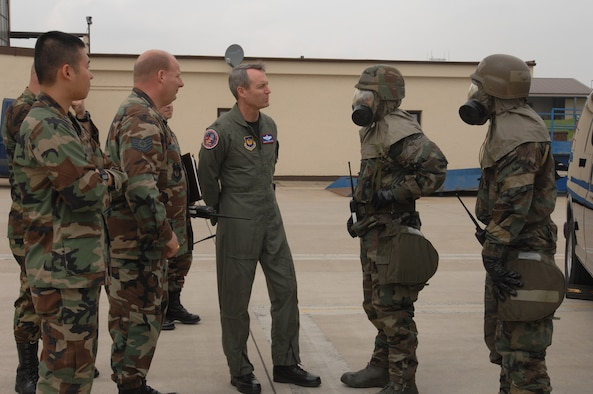 SPANGDAHLEM AIR BASE, GERMANY -- From left: 1st Lt. William Vu, 52nd Aircraft Maintenance Squadron, Tech. Sgt. Michael Powers, 52nd Logistics Readiness Squadron, Col. Darryl Roberson, 52nd Fighter Wing commander, and Tech. Sgt. Timothy Beers and Staff Sgt. Benjamin Turner from 52nd LRS in chemical protective gear. Lieutenant Vu spent the day with the commander as part of the Commander's Shadow Program. Lieutenant Vu, a Houston native, is an assistant officer in charge with the 23rd Aircraft Maintenance Unit and leads more than 219 technicians in six AFSCs. He's been in the Air Force for two years and hopes to earn a master's degree in the next five years. He and the commanders observed Airmen from 52nd AMXS and 52nd LRS as they performed decontamination duties. The units demonstrated their war-fighting skills in preparation for the upcoming NATO OPEVAL. (US Air Force photo/Airman 1st Class Emily Moore)