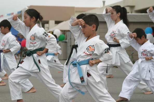 Students from Renshinkan Karate Dojo perform a martial arts demonstration during the Asian Pacific Heritage Month celebration May 26 at the Kadena Air Base, Japan, exchange parking lot. Seven groups performed cultural dances and martial arts demonstrations including: the Philippine Cultural Dancers group, Venoltian Relic, Magahet Pacific Dance group, a live Hawaiian band and the Ron Nix Hamaya Daiko group.