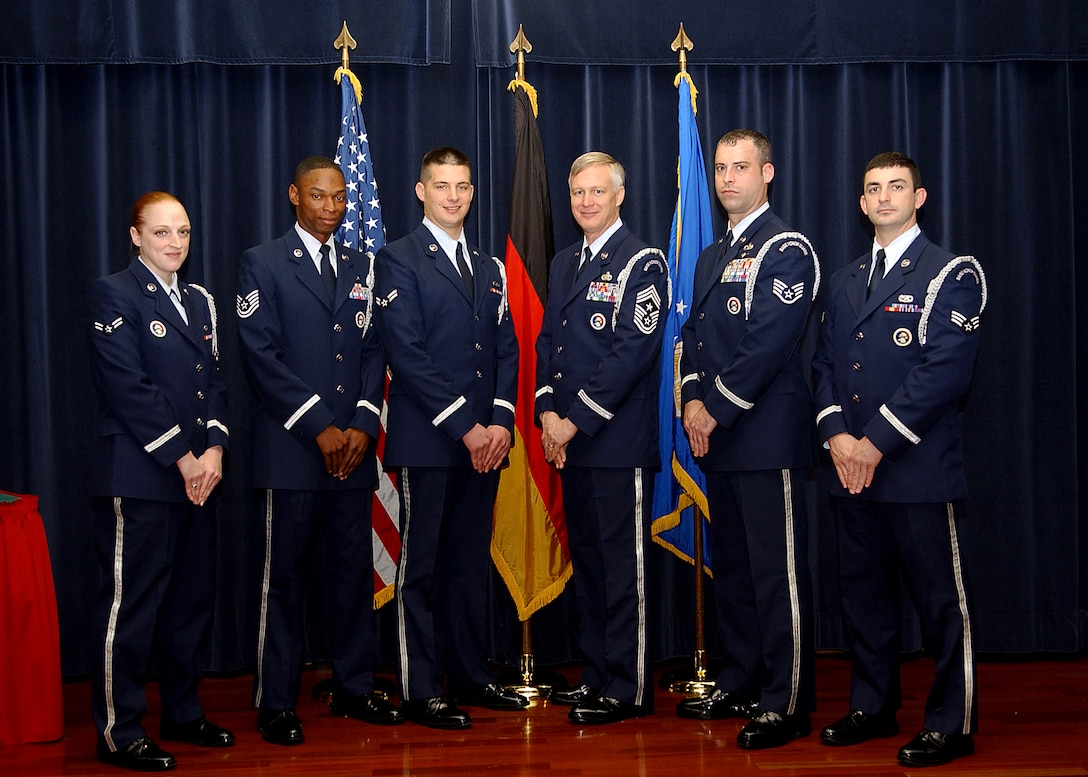 Chief Master Sgt. Vance Clarke, 52nd Fighter Wing command chief, stands in line with members of the Spangdahlem Honor Guard team Oct. 30. Chief Clarke spent the day training with members of the honor guard team to reinforce the importance the duty and encourage supervisors allow their Airmen the ability to participate on the honor guard. (U.S. Air Force photo/Airman 1st Class Allen Pollard)
