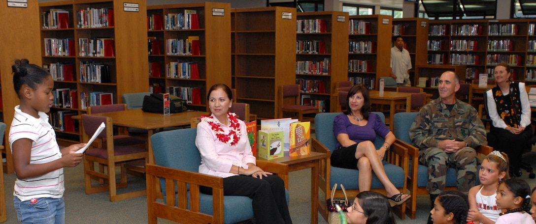 Vivian Aiona is jointed by Mrs. Irene Torres with elementaty school children at the Hickam Library.