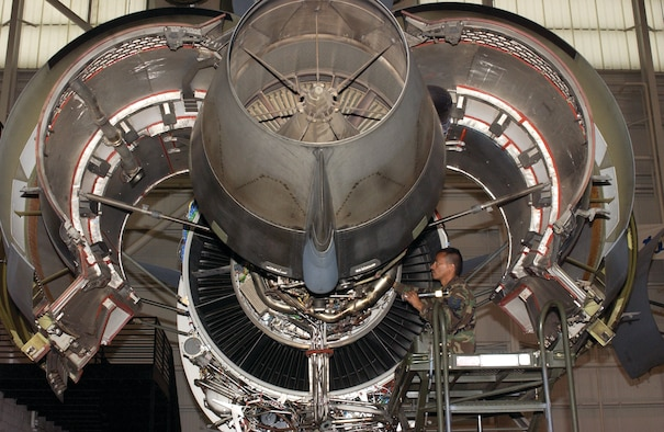 Tech Sgt. David Reyes, a jet engine mechanic with the 452nd Maintenance Squadron, inspects a C-17 Globemaster III engine, parked in the maintenance hangar, for any deficiencies.  (U.S. Air Force photo by Amy Abbott)