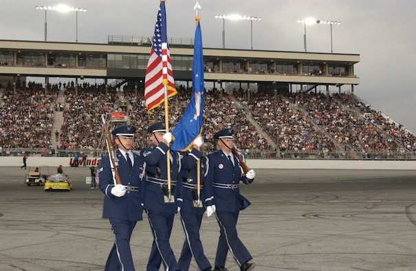 The Blue Eagles Total Force Honor Guard from March ARB performed infront of the massive crowd. (U.S. Air Force photo by Senior Airman David Flaherty)
