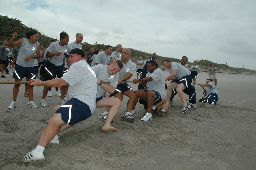 Members of the 45th Medical Group pull for all they're worth in the Olympiad's final event, the tug-of-war on the beach.