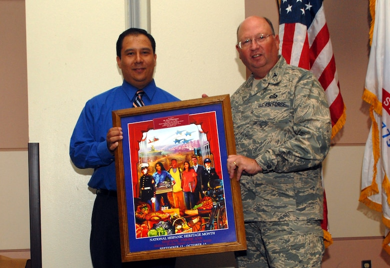 Col. Richard Ayres, 17th Training Wing commander, presents Harold Dominguez, San Angelo city manager with an appreciation gift for being this year's guest speaker. (U.S. Air Force photo by Airman 1st Class Kamaile Chan)