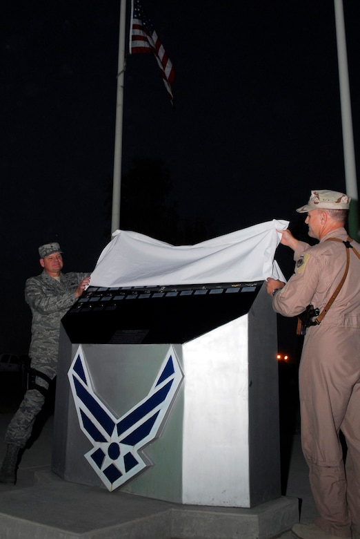 BALAD AIR BASE, Iraq -- Brig. Gen. Dana Simmons, Air Force Office of Special Investigations commander, and Brig. Gen. Burt Field, 332nd Air Expeditionary Wing commander, unveil the names of the three special agents added to the Fallen Airman Memorial here, Nov. 4. Special Agents Thomas Crowell, David Wieger and Nathan Schuldheiss of AFOSI Expeditionary Detachment 2411 paid the ultimate sacrifice Nov. 1. Their names join the other 40 Airmen listed on the memorial who died serving in Iraq. (U.S. Air Force photo/Staff Sgt. Joshua Garcia)